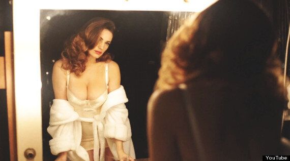 Kelly Brook Debuts New Cleavage-Busting 'Audition' Perfume Ad