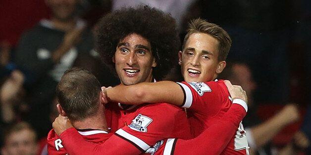 Manchester United's Scottish midfielder Darren Fletcher (2nd R) celebrates scoring the opening goal with...