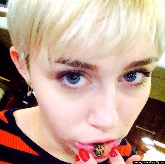 Miley Cyrus Tattoos Cat Emoji On Inside Of Her Bottom Lip, Twerking Singer Shows Off On Instagram