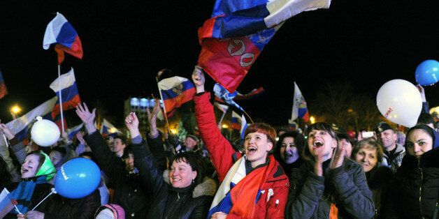 Pro-Russian Crimeans celebrate in Sevastopol on March 16, 2014 after partial showed that about 95.5 percent...