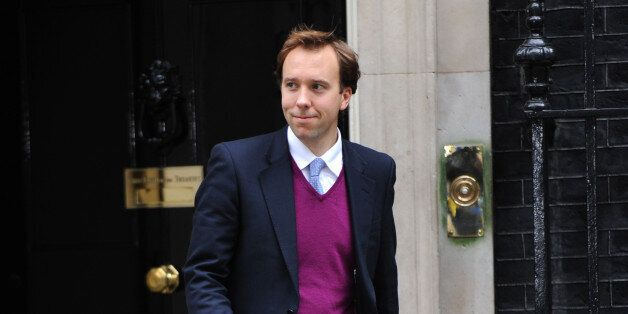 West Suffolk MP Matthew Hancock, leaves 10 Downing Street, London, as Prime Minister David Cameron, kicked...