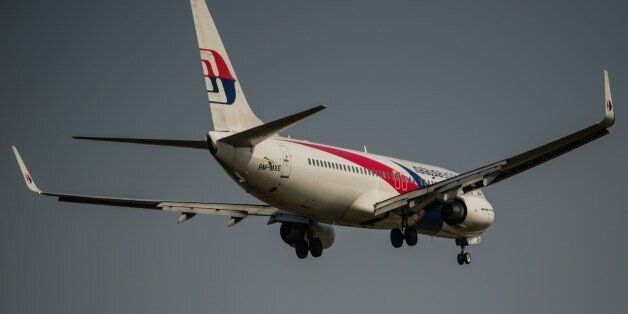 A Malaysia Airlines plane prepares for landing at the Kuala Lumpur International Airport in