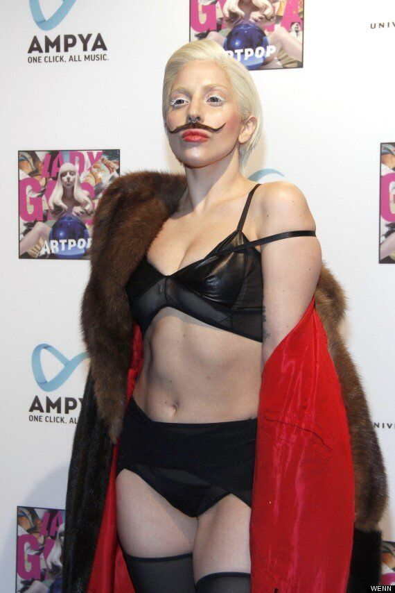 Lady Gaga Wears Giant Furry Purse On Her Head To Promote 'ARTPOP' Album In Germany (VIDEO,