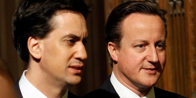 Britain's Prime Minister David Cameron (R) and opposition Labour Party leader Ed Miliband (L) walk together...