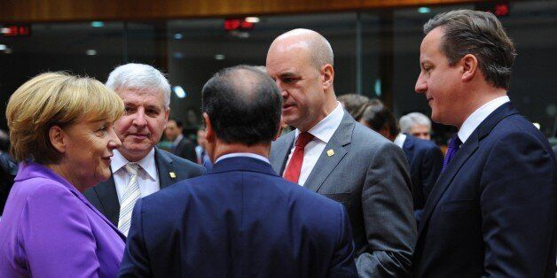 David Cameron speaks with other EU leaders at the Brussels