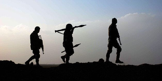 Afghan National Army (ANA) soldiers walk during an operation in Guzara district of Herat on January 26,...