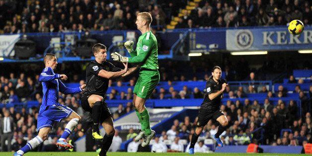 Manchester City's Serbian defender Matija Nastasic (2nd L) heads the ball back past his own goalkeeper...