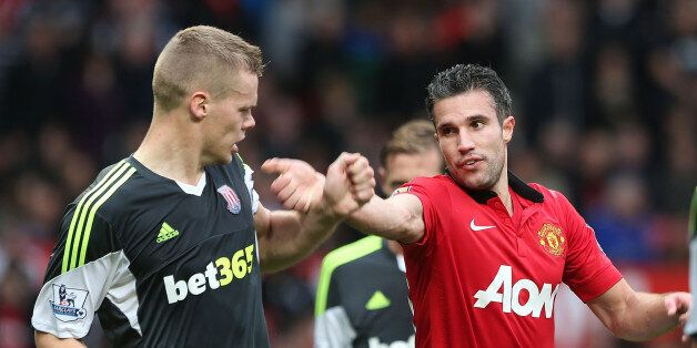 MANCHESTER, ENGLAND - OCTOBER 26: Robin van Persie of Manchester United clashes with Ryan Shawcross of...