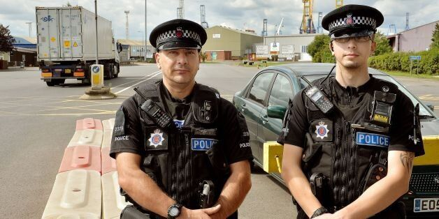 Police officers stand by the main entrance to Tilbury Docks in Essex, where a shipping container was...