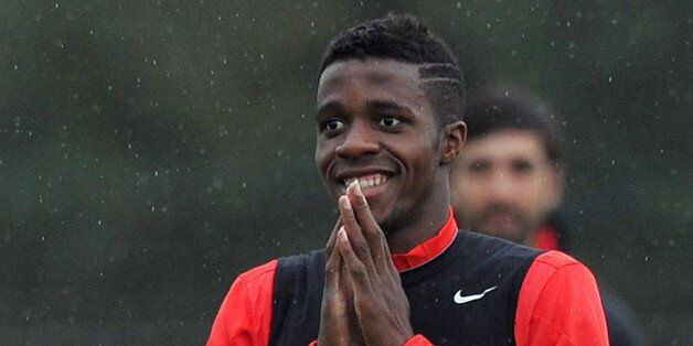 Manchester United's Ivorian-born English striker Wilfried Zaha smiles as he takes part in a training...