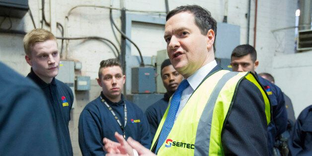 George Osborne, U.K. chancellor of the exchequer, center, gestures as he speaks with apprentices at Sertec...
