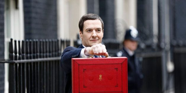 George Osborne, U.K. chancellor of the exchequer, holds the dispatch box containing the 2014 budget as...