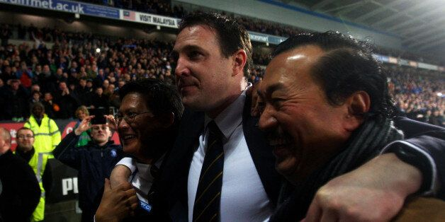 CARDIFF, WALES - JANUARY 24: Malky Mackay the Cardiff City manager celebrates with club owner Tan Sri...
