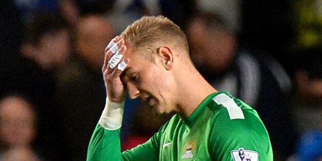 Manchester City's English goalkeeper Joe Hart reacts as he leaves the pitch during the English Premier...