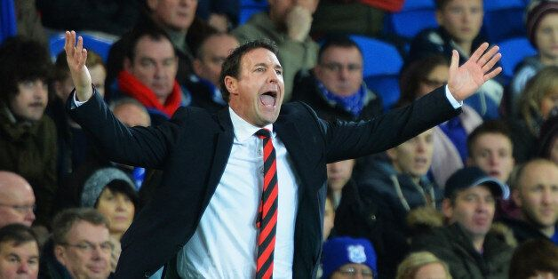 CARDIFF, WALES - DECEMBER 26: Malky Mackay, manager of Cardiff City shows his frustration during the...