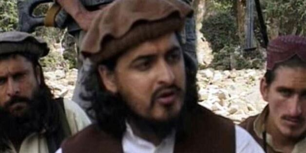 Pakistani Taliban chief Hakimullah Mehsud, pictured sitting with other militants in South Waziristan...