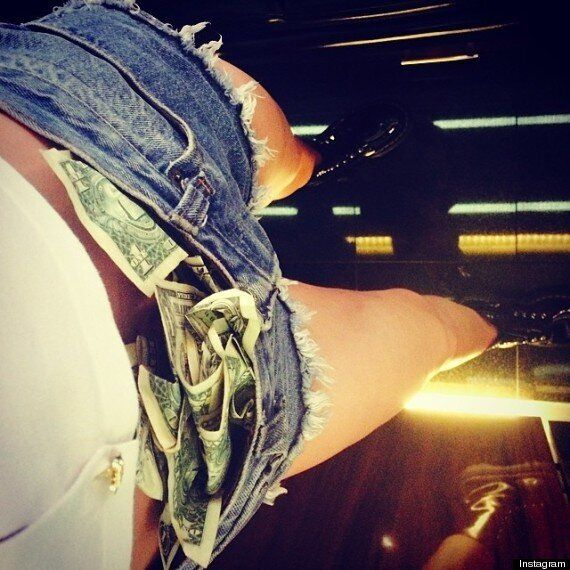 Miley Cyrus Shares Topless Photo And Stripper-Style Pic On