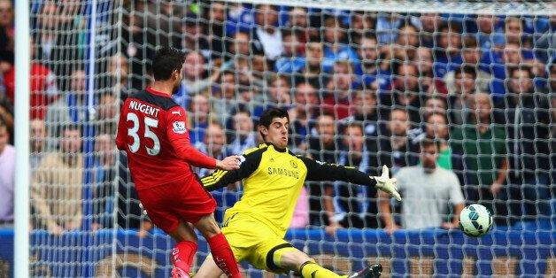 LONDON, ENGLAND - AUGUST 23: Thibaut Courtois of Chelsea saves from David Nugent of Leicester City during...