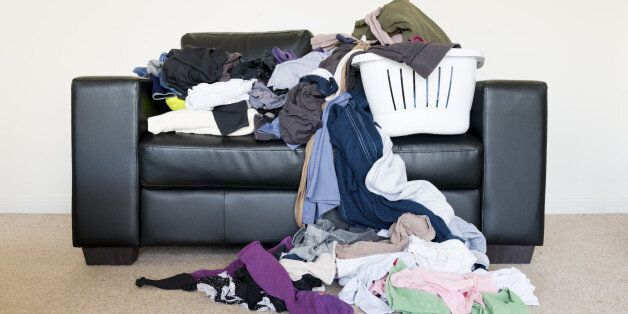 Messy pile of clothes on the sofa