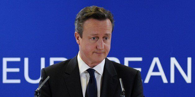 British Prime Minister David Cameron holds a press conference at the end of the two-day European Council...