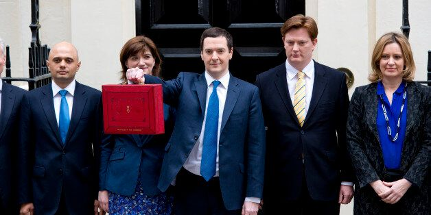 George Osborne leaves Downing Street before delivering his 2014 budget announcement at the House of