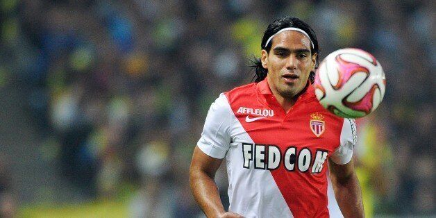 Monaco's Colombian forward Radamel Falcao runs with the ball during the French L1 football match between...
