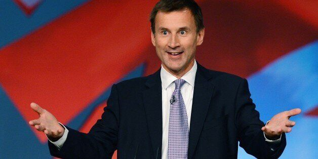 Secretary of State for Health Jeremy Hunt speaks to delegates during the third day of the annual Conservative...
