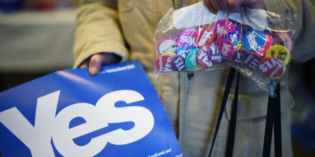 ALEXANDRIA, SCOTLAND - AUGUST 28: An elderly woman holds a bag of badges in a Yes campaign shop on August...