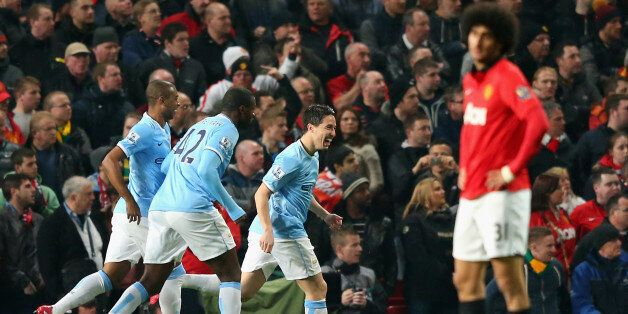 MANCHESTER, ENGLAND - MARCH 25: Samir Nasri of Manchester City celebrates with his team-mates after Edin...
