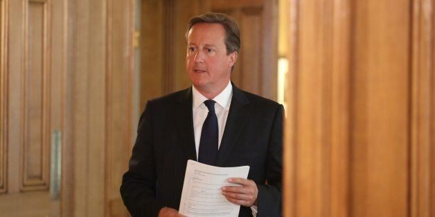 Britain's Prime Minister David Cameron arrives for a news conference in Downing Street, central London...