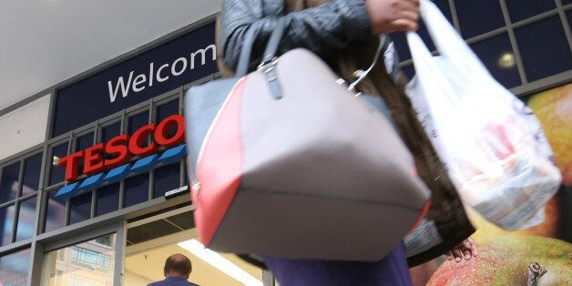 A customer leaves a Tesco Metro supermarket store, operated by Tesco Plc, in London, U.K., on Friday,...