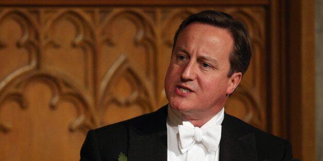 LONDON, ENGLAND - NOVEMBER 11: British Prime Minister David Cameron prepares to deliver his speech in...