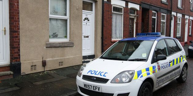 A police car outside the home of Victorino Chua, in Stockport. The 46-year-old male nurse is suspected...