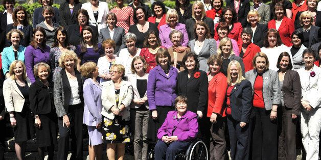 Most of the Labour Party's female MPs, including Harriet Harman (centre) gather on the steps to New Palace...