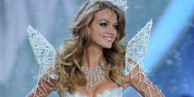 NEW YORK, NY - NOVEMBER 13: Model Lindsay Ellingson walks the runway wearing the 3-D corset, Bustle arm...
