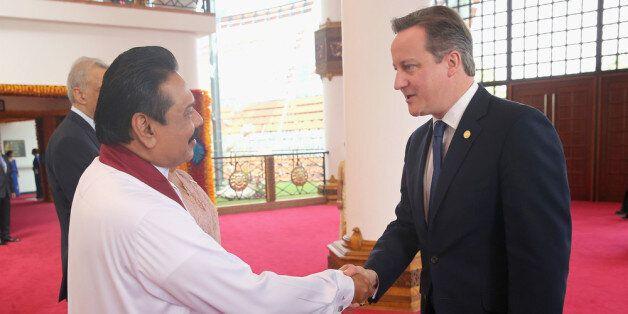 COLOMBO, SRI LANKA - NOVEMBER 15: President Mahinda Rajapaksa of Sri Lanka greets British Prime Minister...