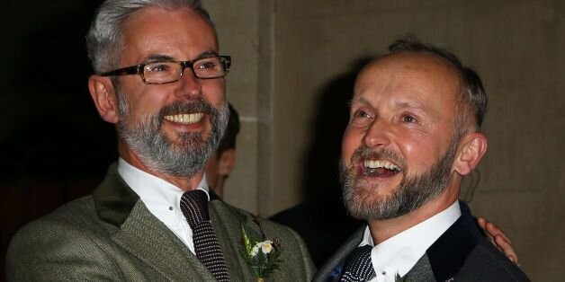 Actor Andrew Wale (left) and guesthouse owner Neil Allard pose for photographs following their wedding...