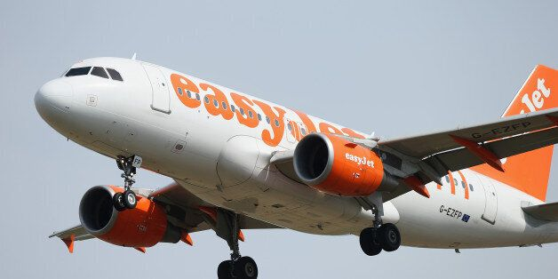 SCHOENEFELD, GERMANY - AUGUST 16: A passenger plane of discount airline easyJet arrives at Schoenefeld...