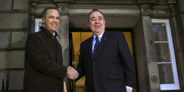 Bank of England governor Mark Carney (left) meeting Scottish First Minister Alex Salmond as he arrives...