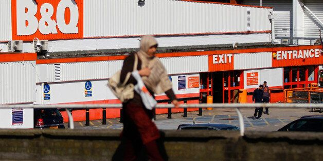 A pedestrian walks past a B&Q home improvement store, operated by Kingfisher Plc, in Manchester, U.K.,...