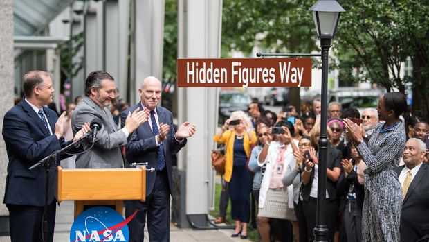 "NASA Administrator Jim Bridenstine, left, U.S. Senator Ted Cruz, R-Texas, second from left, D.C. Council Chairman Phil Mendelson, third from left, and Margot Lee Shetterly, author of the book ""Hidden Figures,"" right, unveil the ""Hidden Figures Way"" street sign at a dedication ceremony, Wednesday, June 12, 2019 at NASA Headquarters in Washington, DC. The 300 block of E Street SW in front of the NASA Headquarters building was designated as ""Hidden Figures Way"" to honor Katherine Johnson, Dorthy Vaughan, Mary Jackson and all women who have dedicated their lives to honorably serving their country, advancing equality, and contributing to the space program of the United States. Photo Credit: (NASA/Joel Kowsky)"