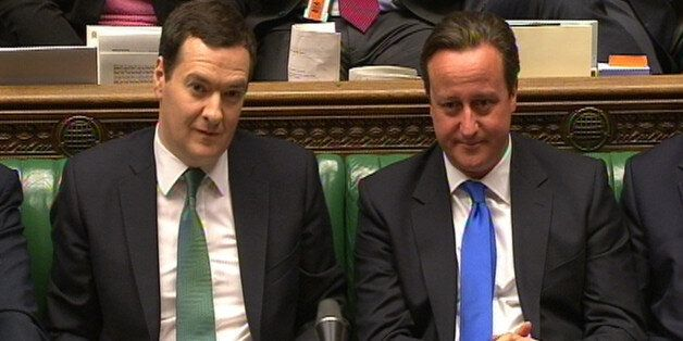 Chancellor of the Exchequer George Osborne and Prime Minister David Cameron listen as Shadow Chancellor...