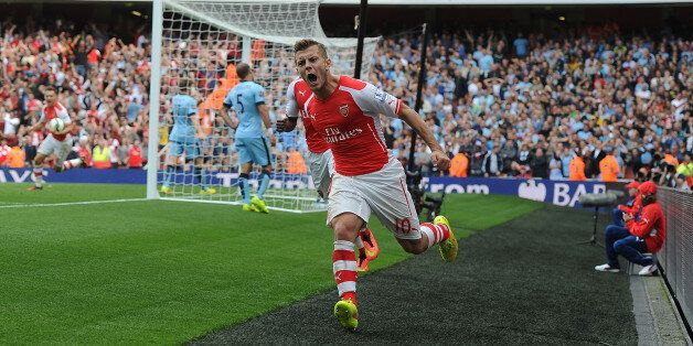LONDON, ENGLAND - SEPTEMBER 13: Jack Wilshere celebrates scoring for Arsenal during the Barclays Premier...