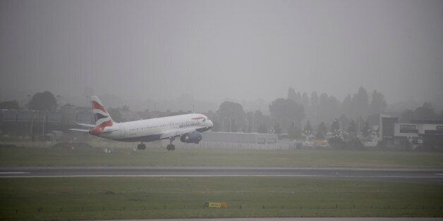 A plane lands at Heathrow Airport, west London as much of southern England has been blanketed in thick...