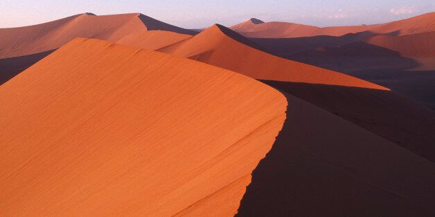NAMIBIA Namib Desert Red sand dunes partially cast in