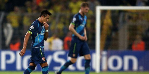 DORTMUND, GERMANY - SEPTEMBER 16: Alexis Sanchez and Per Mertesacker of Arsenal looks dejected during...