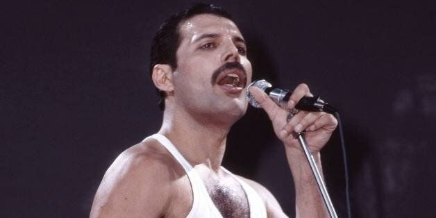 LONDON - JULY 13: Freddie Mercury of Queen performs on stage at Live Aid at Wembley Stadium on 13th July...