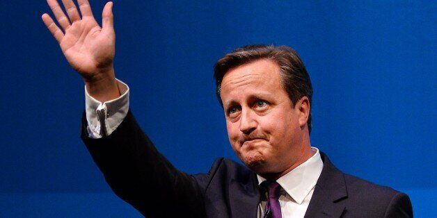 British Prime Minister David Cameron gestures after addressing a press conference in Aberdeen, Scotland,...