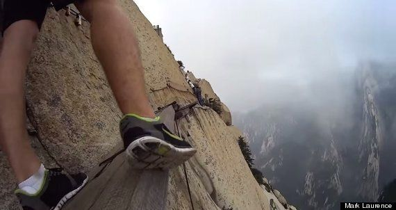 Man Removes Harness To Walk Across Plank Between