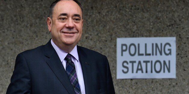 Scotland's First Minister Alex Salmond poses after casting his vote at a polling station in Strichen,...